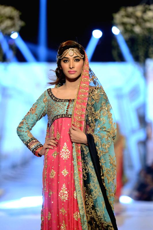 A model presents a creation by designer Tena Durrani during the first day of the Bridal couture Week in southern Pakistani port city of Karachi, May 9, 2014.