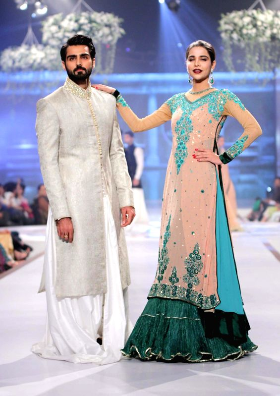 Models present creations by designer Mansoor Akram during the first day of the Bridal couture Week in southern Pakistani port city of Karachi on May 9, 2014.