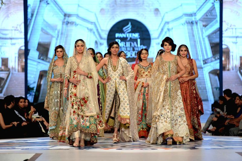 Models present creations by designer Tena Durrani during the first day of the Bridal couture Week in southern Pakistani port city of Karachi on May 9, 2014.