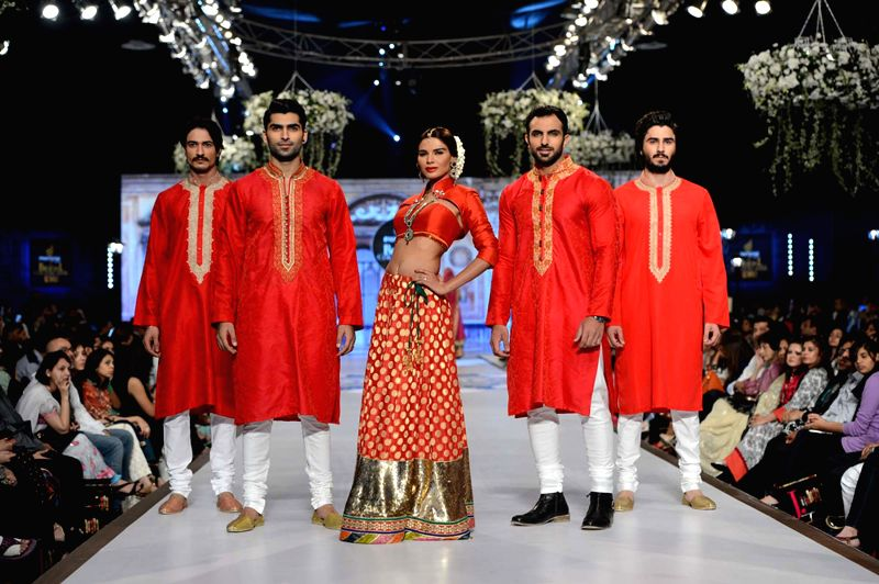 Models present creations by designer Nomi Ansari during the first day of the Bridal couture Week in southern Pakistani port city of Karachi on May 9, 2014.