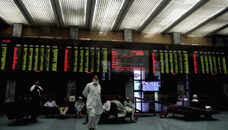 Pakistani stockbrokers sit under a digital screen during a trading session at the Karachi Stock Exchange (KSE) in southern Pakistani port city of Karachi on May 15, .