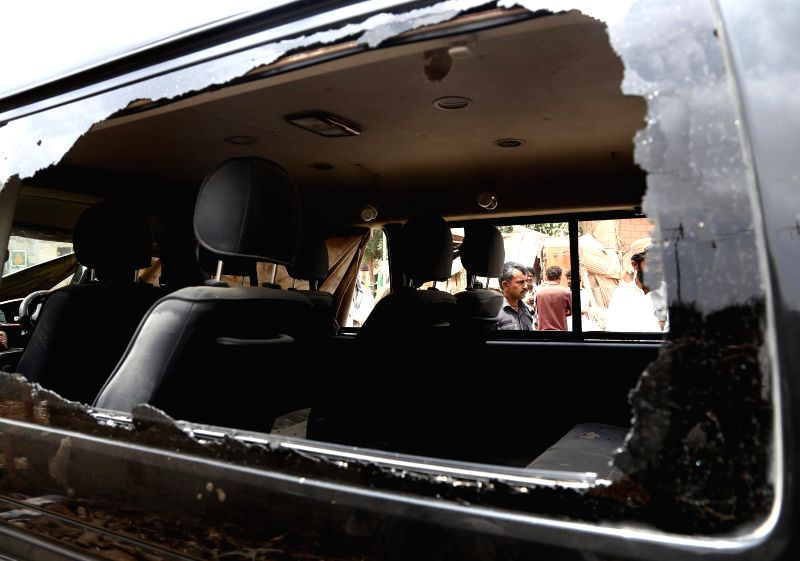KARACHI, May 30, 2016 - Photo taken on May 30, 2016 shows a damaged vehicle at the blast site in Karachi, Pakistan. Three people including one foreigner were injured when a blast hit a vehicle in ...