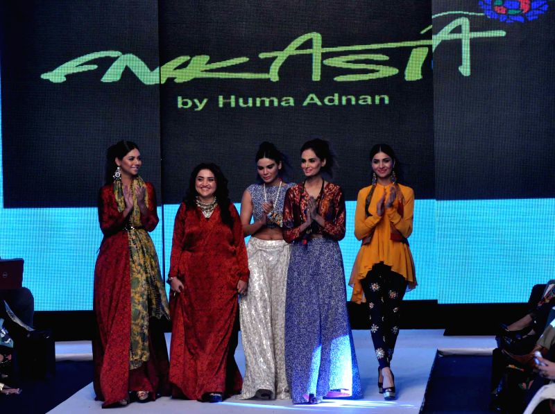 Karachi (Pakistan): Models present creations by fashion designer FnkAsia on the second day of Pakistan Fashion Week in Karachi, Pakistan, on Nov. 26, 2014. The three-day Pakistan Fashion Week ...