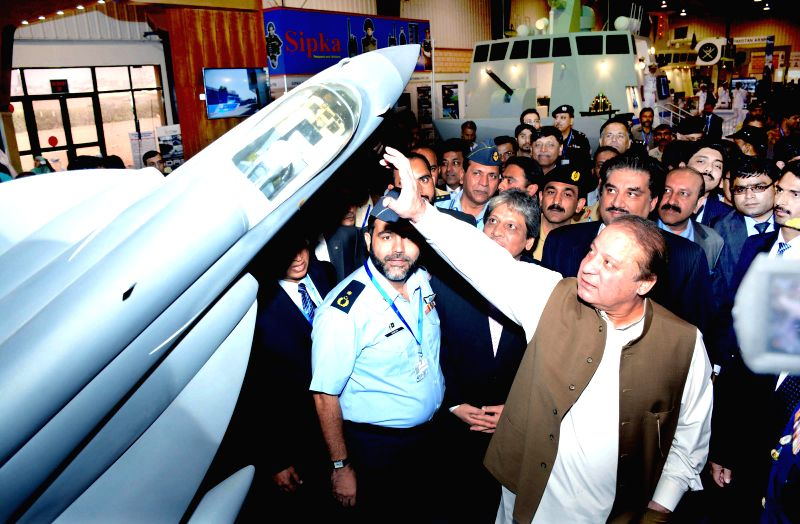 Karachi (Pakistan): Photo released by Press Information Department (PID) shows Pakistani Prime Minister Nawaz Sharif (R, front) visiting a stall during the 8th International Defense Exhibition and ...