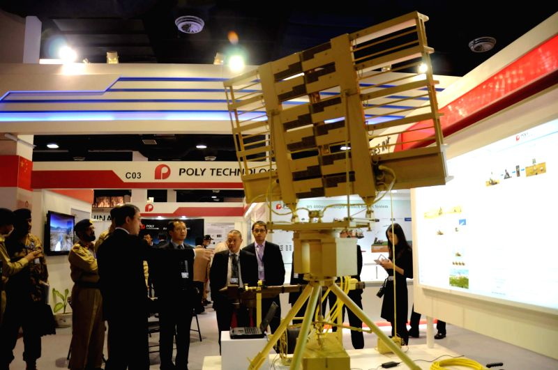 People visit a stall during the International Defence Exhibition and Seminars (Ideas) in southern Pakistani port city of Karachi, Dec. 2, 2014. Over 300 exhibitors including 77 Pakistani ...