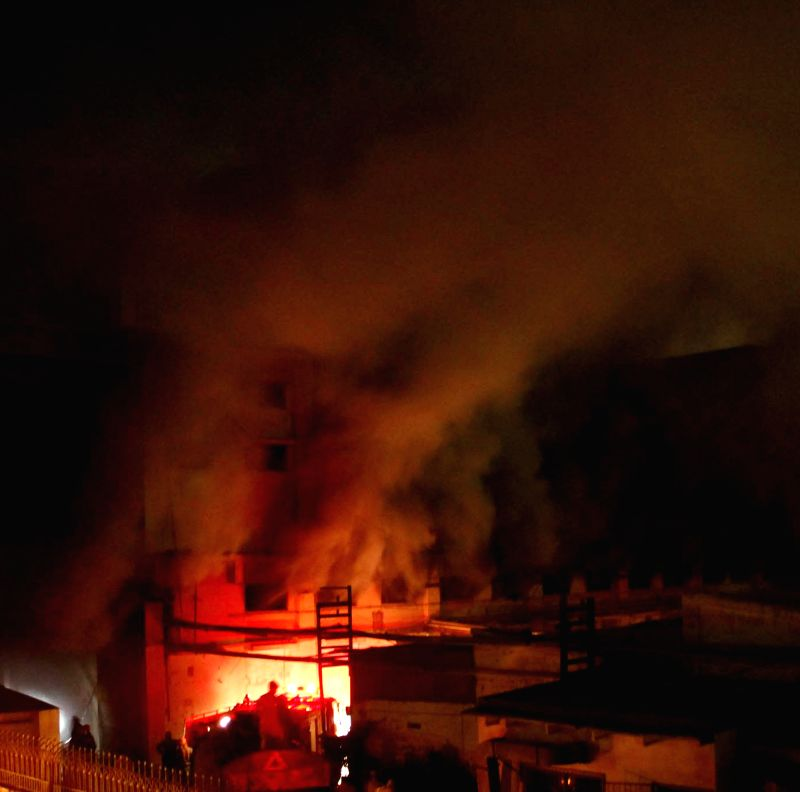 Photo taken on Dec. 5, 2014 shows a scene of the site of fire accident in southern Pakistani port city of Karachi. A textile factory in Karachi caught fire on Friday night. ...