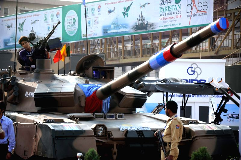Visitors look at a tank during the International Defence Exhibition and Seminars (Ideas) in southern Pakistani port city of Karachi, Dec. 2, 2014. Over 300 exhibitors including 77 Pakistani