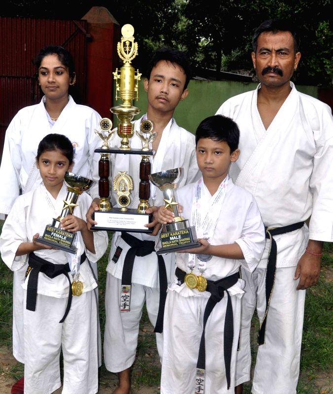 Karate Championship 2014 held at Bhogeswari Baruani Indoor Stadium, Dispur recently, from (R) Rishiraj Das best karate boys Prabhatansu Phukan best karate of the championchip and Kristi Diganta best .