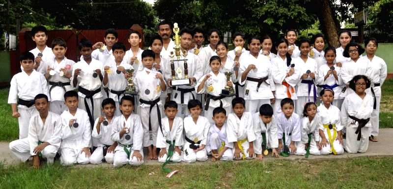 Karate Players of Martial Arts Dozen, Dispur showing Best team trophy receive during the 13th All Guwahati Karate Championship 2014 held at Bhogeswari Baruani Indoor Stadium, Dispur recently, in ...