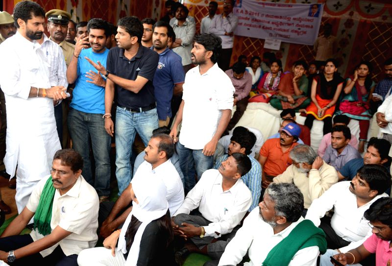 Karnataka Administrative Service aspirants  stage a demonstration against alleged illegal recruitment in Bangalore on Aug 7, 2014.