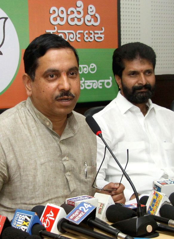 Karnataka BJP president Prahlad Joshi and party leader C T Ravi during a press conference in Bangalore on May 13, 2014. - Prahlad Joshi