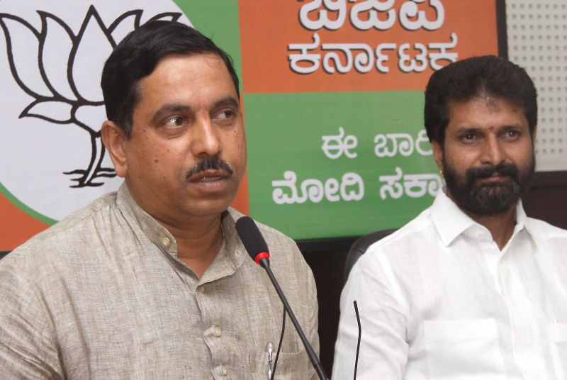 Karnataka BJP president Prahlad Joshi and party leader C T Ravi during a press conference in Bangalore on May 13, 2014.