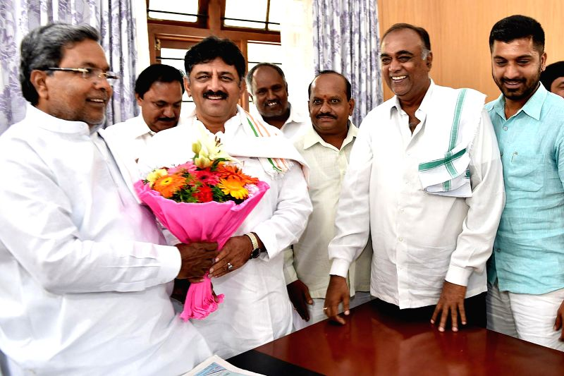 Karnataka Chief Minister and Congress leader Siddaramaiah and others celebrate after the party wrested the Bellary Rural legislative assembly seat in Karnataka; in Bangalore on Aug 25, 2014. N.Y. ...