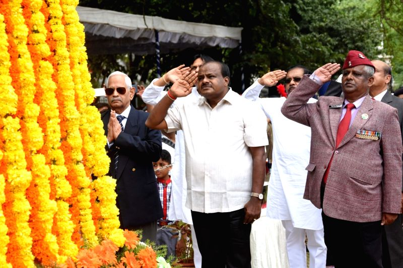 Karnataka Chief Minister H. D. Kumaraswamy and Deputy Chief Minister G. Parameshwara pay homage to the martyrs on the occasion of Kargil Vijay Diwas at National Military Memorial Park, in ... - H. D. Kumaraswamy