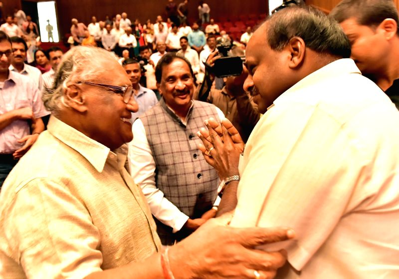 Karnataka Chief Minister H. D. Kumaraswamy with Vision Group on Science and Technology Chairman CNR Rao during an award ceremony at J N Tata Auditorium, IISc., in Bengaluru on Aug 6, 2018. - H. D. Kumaraswamy