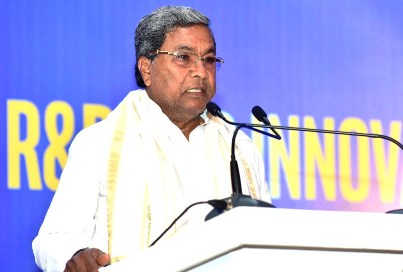 Karnataka Chief Minister Siddaramaiah  addresses during a press conference to announce Intel's investment and expansion plans in the Indian sub-continent, in Bengaluru, on June 14, 2017. - Siddaramaiah