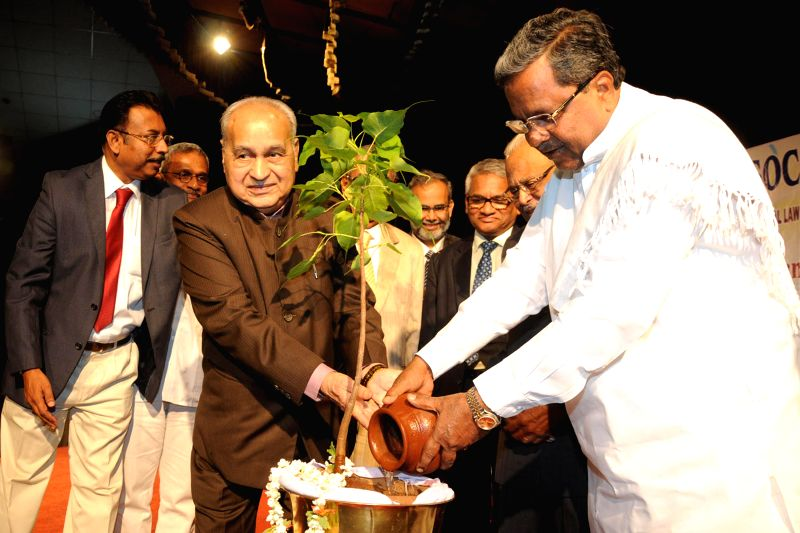 Karnataka Chief Minister Siddaramaiah and Justice Justice M. Rama Jois during the National Seminar on National Judicial Appointments Commission Bill 2014 organised by Lawyers Forum for Social ... - Siddaramaiah