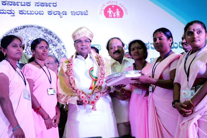 Karnataka Chief Minister Siddaramaiah being felicitated by Accredited social health activists (ASHAs) during a programme organised on World Population day by Karnataka Government's Health and Family . - Siddaramaiah