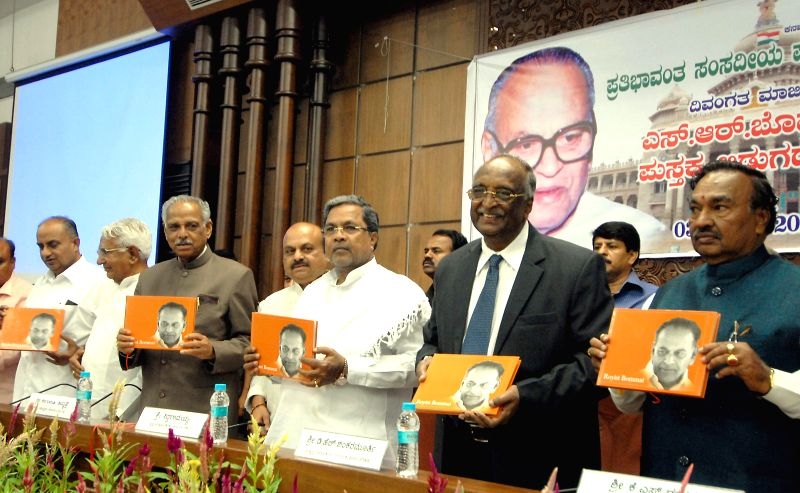 Karnataka Chief Minister Siddaramaiah, BJP leader Basavaraj Bommai, Karnataka Assembly Speaker Kagodu Thimmappa, Karnataka Ministers H S Mahadev Prasad and C M Udasi and other during launch of a book - Siddaramaiah, H S Mahadev Prasad and C M Udasi