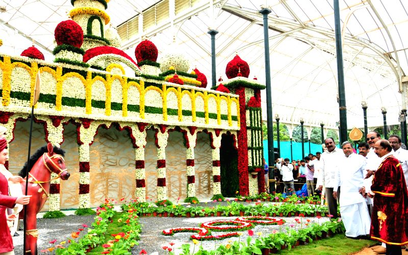 Karnataka Chief Minister Siddaramaiah during inauguration of Independence Day flower show at Glass House in Lal Bagh of Bangalore on Aug 8, 2014. - Siddaramaiah
