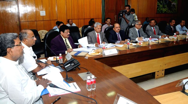 Karnataka Chief Minister Siddaramaiah during a review meeting with  senior officers on Chamarajanagar developmental works in Bangalore on May 5, 2014. - Siddaramaiah