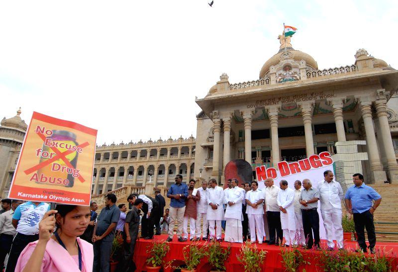 Karnataka Chief Minister Siddaramaiah during a programme organised to flag-off an anti-drug walkathon from Vidhana Soudha in Bangalore on July 7, 2014. - Siddaramaiah