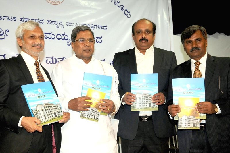 Karnataka Chief Minister Siddaramaiah during a programme organised to launch citizen charter of Karnataka Public Service Commission (KPSC) at Udhyoga Soudha in Bangalore on July 16, 2014. - Siddaramaiah