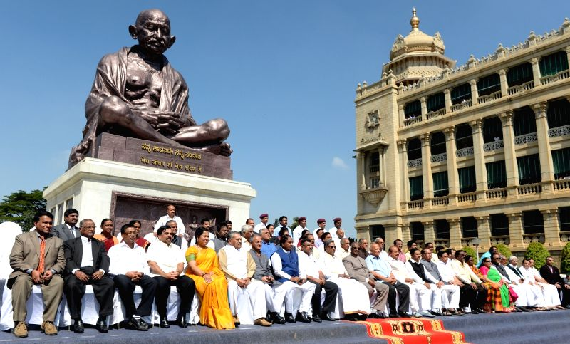 Karnataka Chief Minister Siddaramaiah during a group photo with the legislators retiring from the Upper House at Vidhana Soudha in Bengaluru, on Nov 26, 2015.