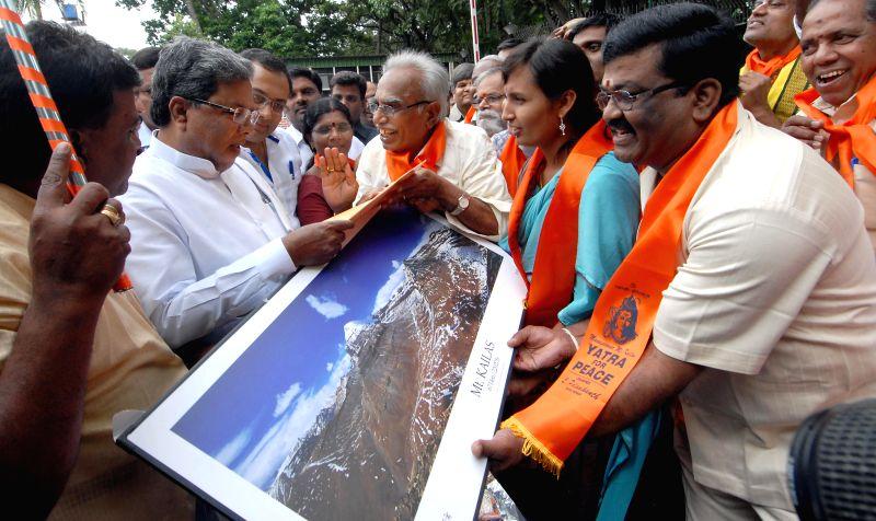 Karnataka Chief Minister Siddaramaiah flags-off Mansarovar Kailash Yatra for National Integration and Peace in Bangalore on Aug 5, 2014. - Siddaramaiah