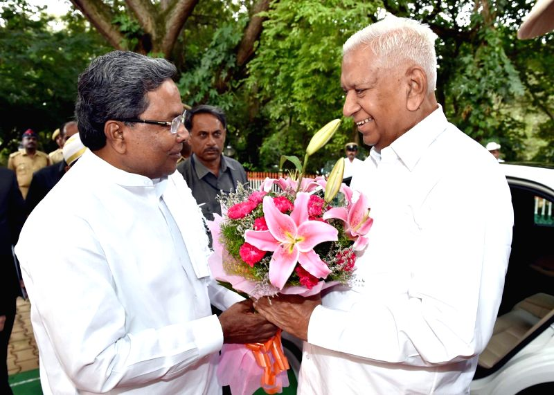 Karnataka Chief Minister Siddaramaiah greets newly appointed Karnataka Governor Vajubhai during later's swearing-in ceremony as the Governor of the state at Raj Bhavan in Bangalore on Sept 1, 2014. - Siddaramaiah