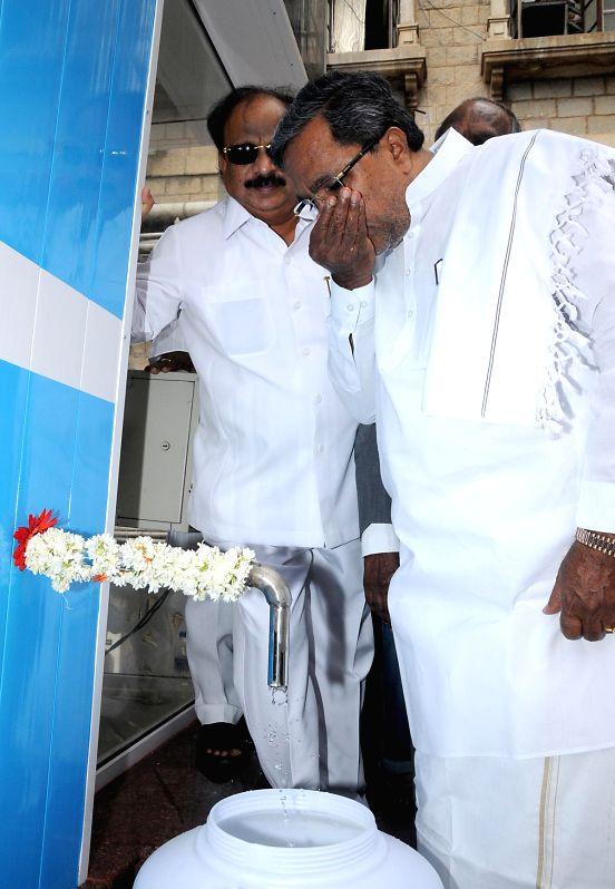 Karnataka Chief Minister Siddaramaiah inaugurates Pure drinking water units at Vidhana Soudha in Bangalore on July 30, 2014. - Siddaramaiah
