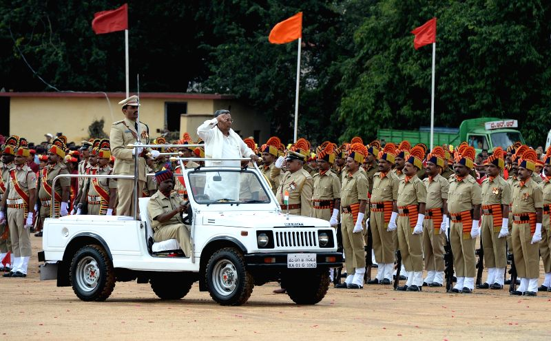 Karnataka Chief Minister Siddaramaiah inspects Guard of Honour during Independence Day celebrations at Manekshaw Parade Grounds in Bangalore on Aug 15, 2014.