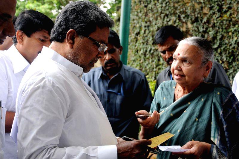 Karnataka Chief Minister Siddaramaiah interacts with public during Janata Darshan in Bangalore on May 5, 2014.
