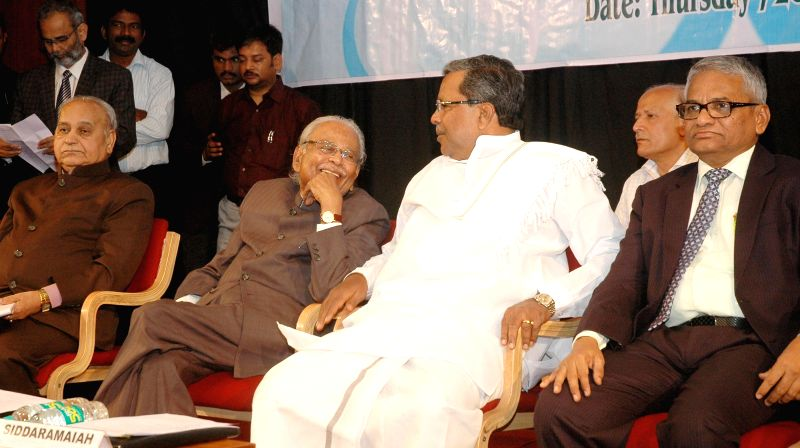 Karnataka Chief Minister Siddaramaiah, Justice VS Malimath and others during the National Seminar on National Judicial Appointments Commission Bill 2014 organized by Lawyers Forum for Social Justice, - Siddaramaiah