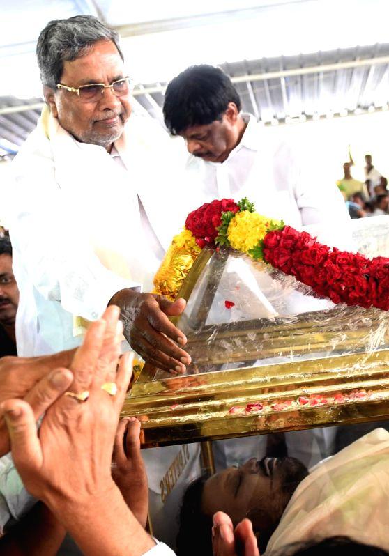 Karnataka Chief Minister Siddaramaiah mourns at the funeral of his elder son Rakesh Siddaramaiah at the Dasara Expo Grounds in Mysuru, on Aug 1, 2016. Rakesh Siddaramaiah who passes away at ... - Siddaramaiah