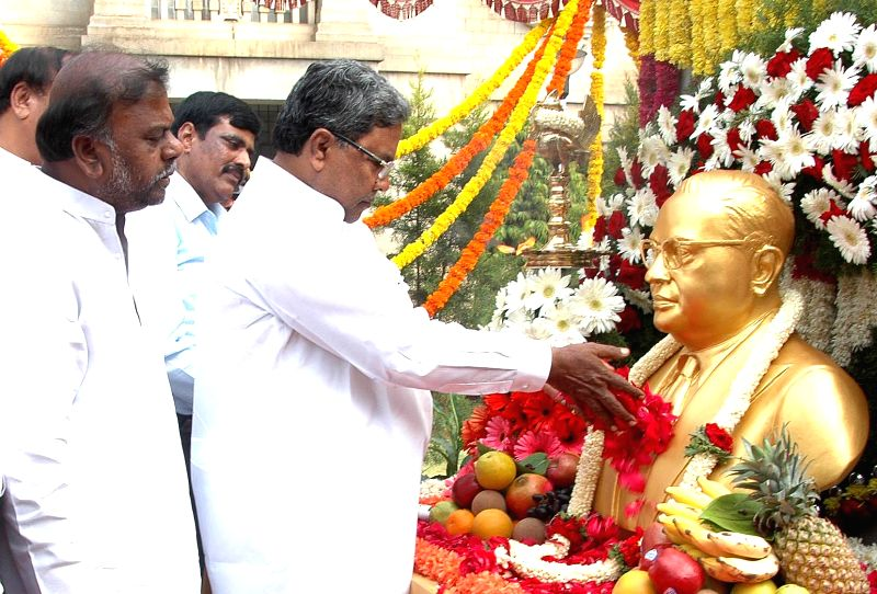 Karnataka Chief Minister Siddaramaiah pays tribute to Dr. BR Ambedkar on his birth anniversary in Bangalore on April 14, 2014.