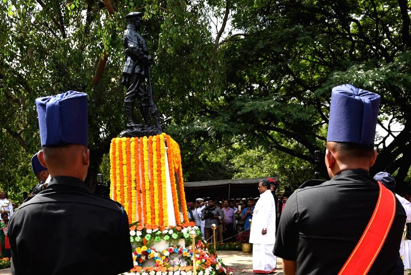 Karnataka Chief Minister Siddaramaiah pays tribute to the soldiers who sacrificed their lives on the occasion of Kargil Vijay Diwas at the National Military Memorial, in Bengaluru on July ... - Siddaramaiah
