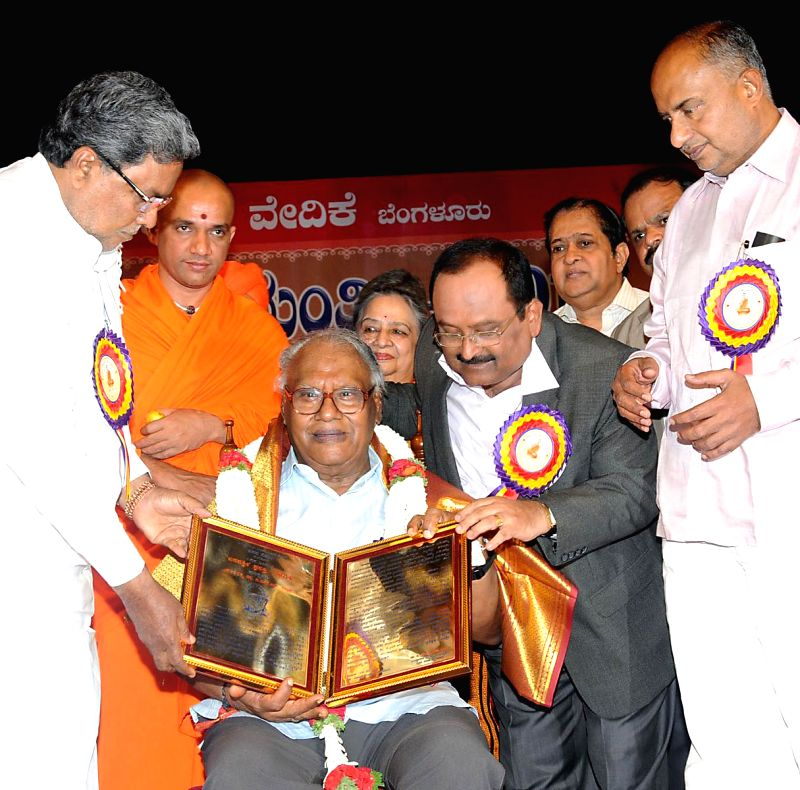 Karnataka Chief Minister Siddaramaiah presents `Basava Sri` award to Dr. CNR Rao during a programme organised by Basava Vedike at Ravindra Kalakshetra in Bangalore on May 4, 2014.