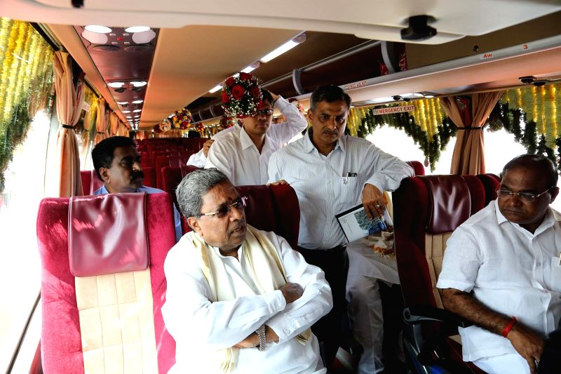 Karnataka Chief Minister Siddaramaiah takes ride in the Airavat Club Class bus after flagging it off at Vidhan Soudha in Bengaluru on Sept 13, 2017. - Siddaramaiah