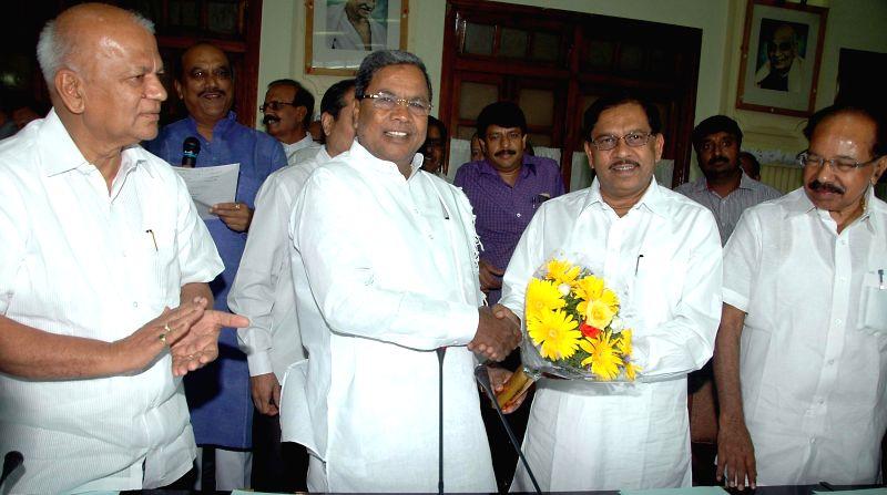 Karnataka Chief Minister Siddaramaiah with Karnataka Pradesh Congress Committee (KPCC) president Dr. G Parameshwara, party leader M Veerappa Moily and others during a Congress Legislative Party ... - Siddaramaiah