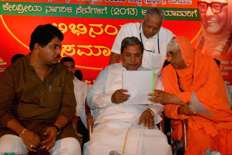 Karnataka Chief Minister Siddaramaiah with Shivarathri Deshikendra Mahaswami and others during a programme organised to felicitate candidates who cleared Central Civil Services at JSS Auditorium in .. - Siddaramaiah