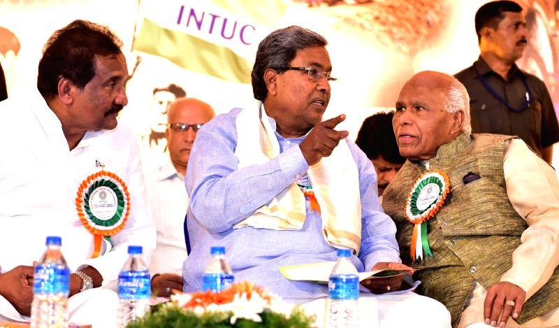 Karnataka Chief Minister Siddaramaiah with ministers KJ George, Roshan Baig and others during Foundation Day programme of Indian National Trade Union Congress (INTUC) at Palace Grounds in ... - Siddaramaiah