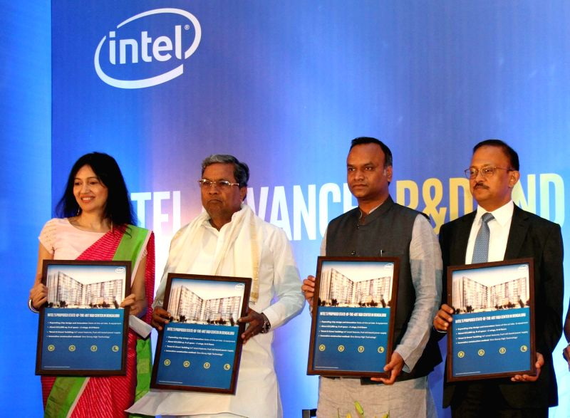 Karnataka Chief Minister Siddaramaiah with Karnataka IT minister Priyank Kharge and Intel India General Manager Nivruti Rai during a press conference to announce US-based multinational's ... - Siddaramaiah and Manager Nivruti Rai