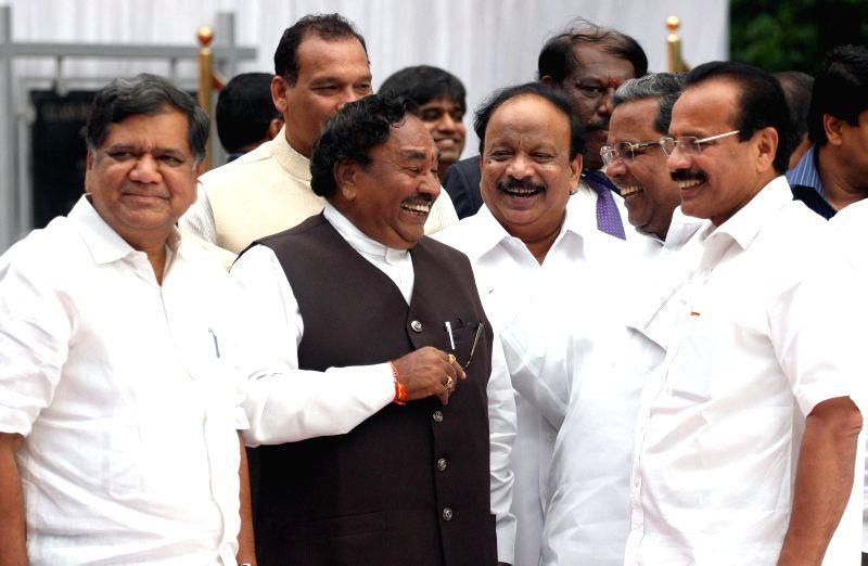 Karnataka Chief Minister Siddaramaiah with the leader of opposition in the Karnataka Assembly and a BJP leader Jagadish Shettar, Union Railway Minister Sadananda Gowda, BJP leader K. S. Eshwarappa ... - Siddaramaiah