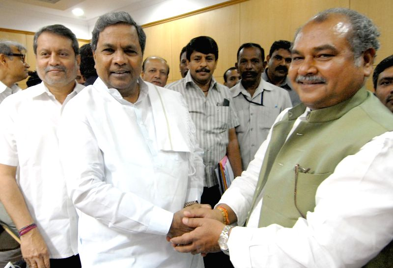 Karnataka Chief Minister Siddaramaiah with Union Minister of Mines, Steel and Labour and Employment Narendra Singh Tomar at Vidhana Soudha in Bangalore on July 4, 2014.
