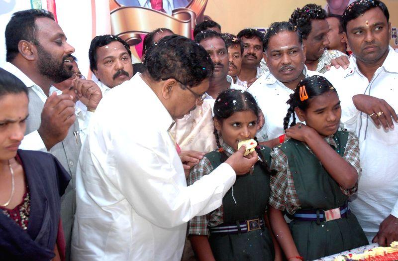 Karnataka Congress chief G. Parameshwara celebrates his 63rd birthday with visually challenged students in Bangalore on Aug 6, 2014.