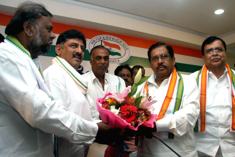 Karnataka Congress chief G. Parameshwara and other party leaders celebrate after the party wrested the Bellary Rural legislative assembly seat in Karnataka; in Bangalore on Aug 25, 2014. N.Y. ...