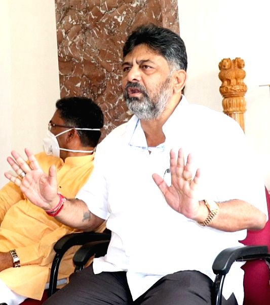 Karnataka Congress President DK Shivakumar talks to the media at his residence in Bengaluru during the extended nationwide lockdown imposed to mitigate the spread of coronavirus; on Apr 24, 2020.