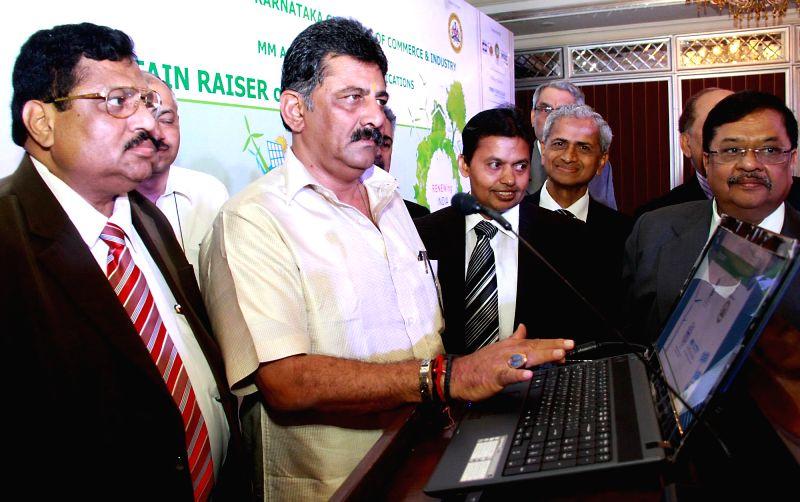 "Karnataka Energy Minister D K Shivakumar and FKCCI President R Shivakumar during inauguration of ""Green Summit - 2014"" organised by FKCCI in Bangalore on May 14, 2014. - D K Shivakumar"