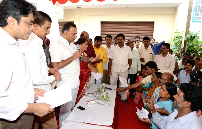 Karnataka Food and Civil Supplies Minister Gundu Rao interacts with BPL card holders during `Anna Bhagya Adalat` organised by food and civil supplies department in Bangalore on July 7, 2014. - Gundu Rao